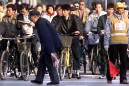 Chinese people at an intersection. Click image to expand.