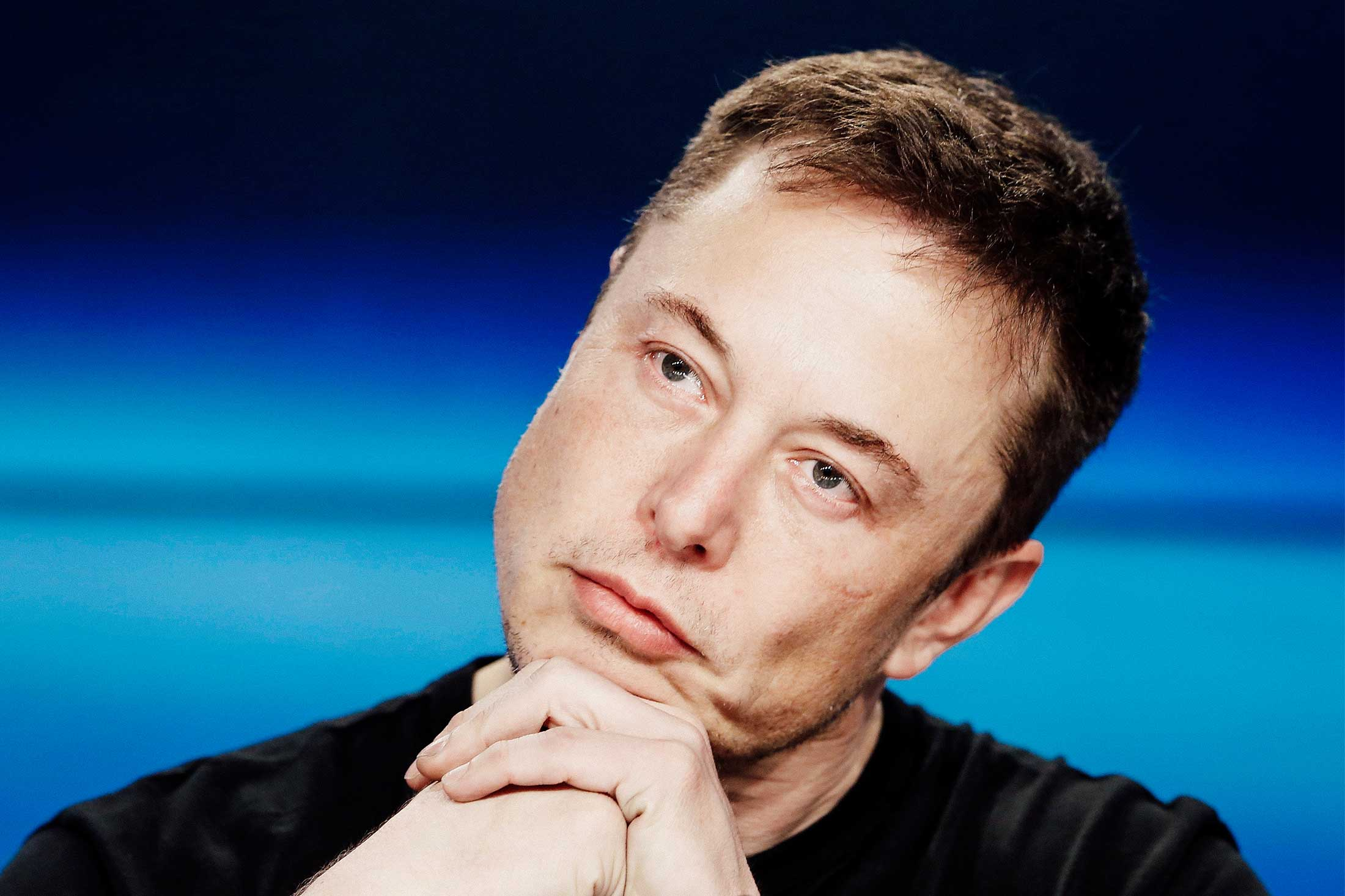 Elon Musk listens at a press conference following the first launch of a SpaceX Falcon Heavy rocket at the Kennedy Space Center in Cape Canaveral, Florida, on Feb. 6.