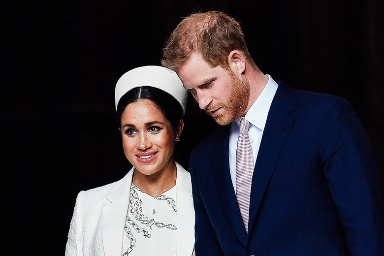 Meghan and Harry standing close to each other in formal attire.