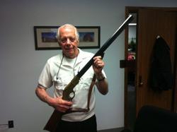 Jack Davis holds a gun. Click image to expand.
