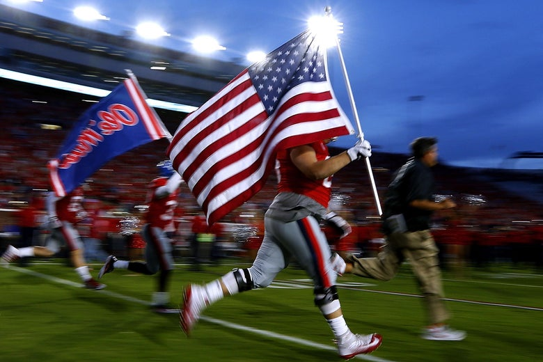 OXFORD, MS - OCTOBER 21: The Mississippi Rebels carry an American flag as they take the field before a game against the LSU Tigers at Vaught-Hemingway Stadium on October 21, 2017 in Oxford, Mississippi.  (Photo by Jonathan Bachman/Getty Images)