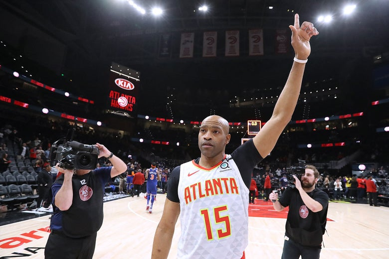 Vince Carter points his finger to the roof in farewell
