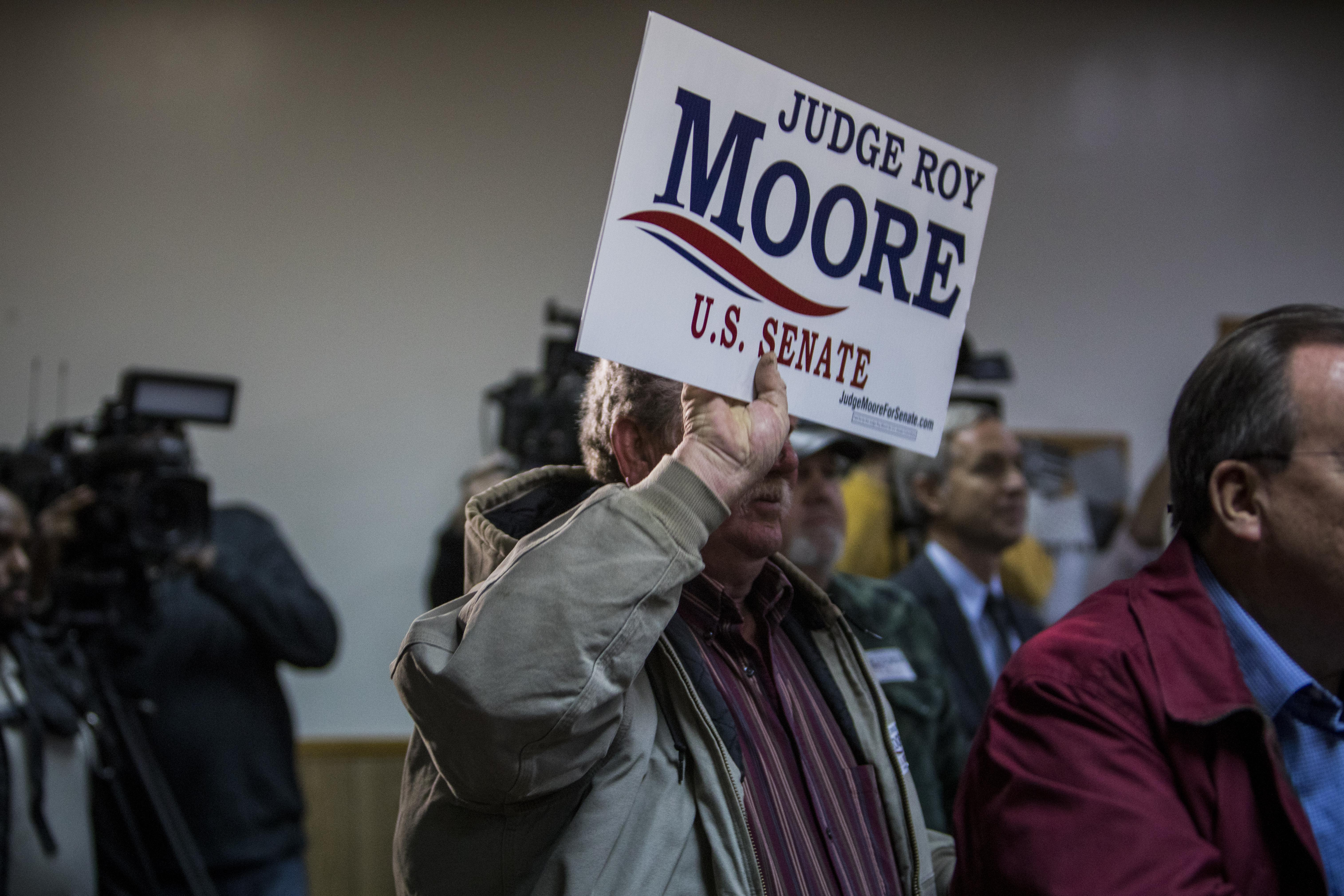 HENAGAR, AL - NOVEMBER 27: Judge Roy Moore supporters listen during a campaign rally on November 27, 2017 in Henagar, Alabama. Over 100 people turned out to the event packing the Henagar Event Center. (Photo by Joe Buglewicz/Getty Images)