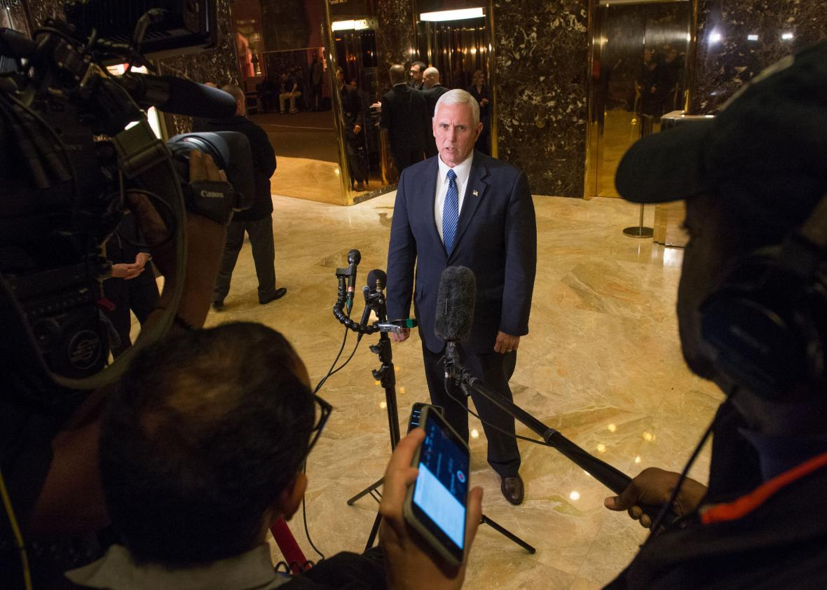 Vice-president-elect Mike Pence speaks with the press as he leaves Trump Tower in New York November 29, 2016.