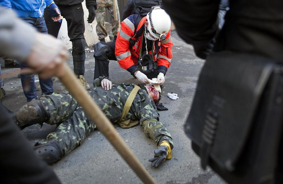 A protester who was injured during clashes with government police receives medical treatment in Kiev on Feb.18, 2014. UKRAINE/