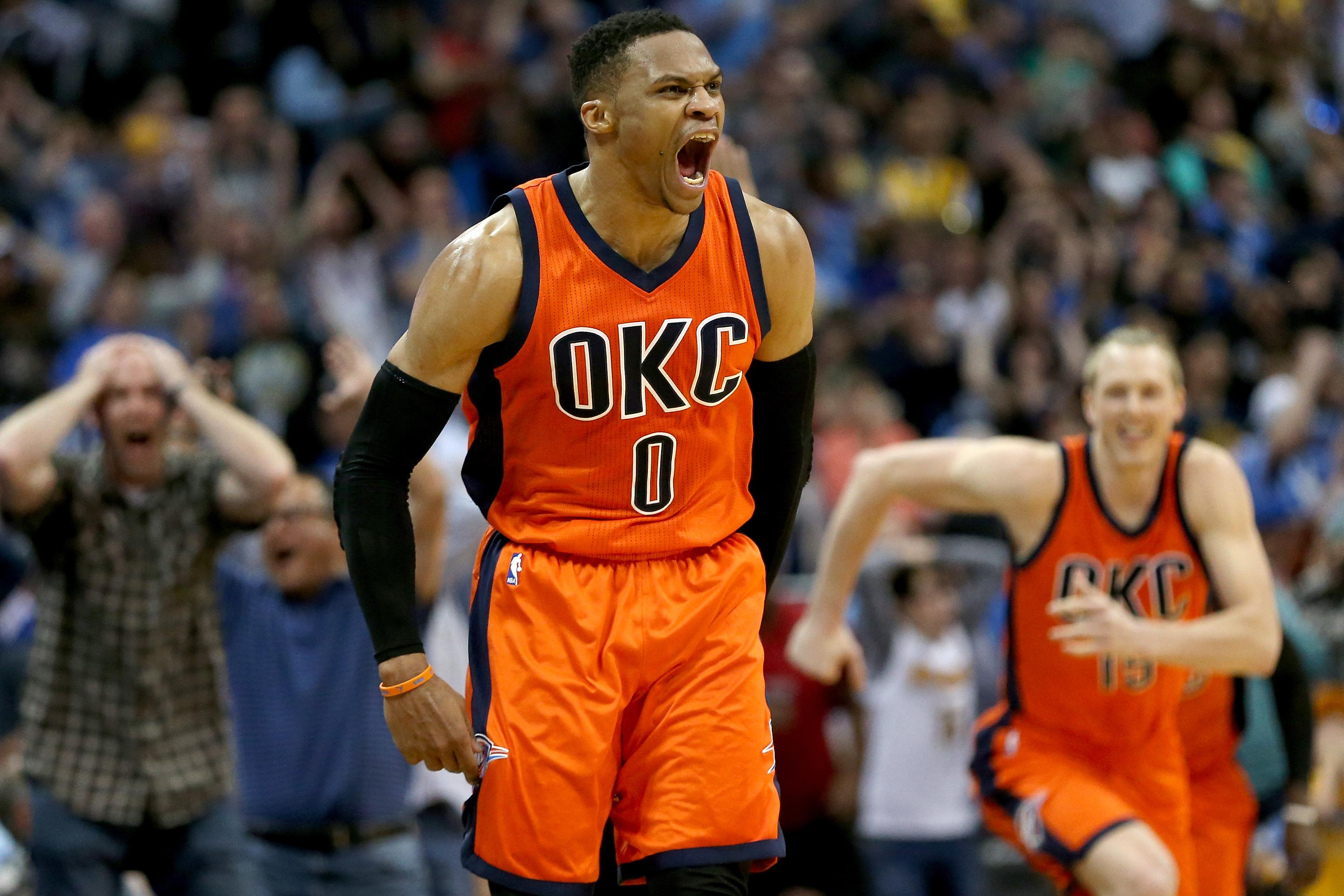 DENVER, CO - APRIL 09:  Russell Westbrook #0 of the Oklahoma City Thunder celebrates after scoring a game-winning, three-point shot at the buzzer against the Denver Nuggets at Pepsi Center on April 9, 2017 in Denver, Colorado. NOTE TO USER: User expressly acknowledges and agrees that , by downloading and or using this photograph, User is consenting to the terms and conditions of the Getty Images License Agreement.  (Photo by Matthew Stockman/Getty Images)