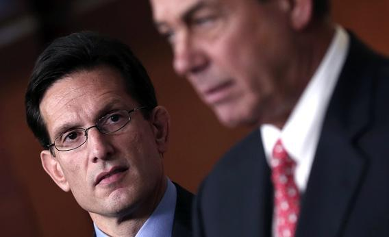 Speaker of the House John Boehner (R-OH), right, speaks during a press conference as House Majority Leader Eric Cantor.