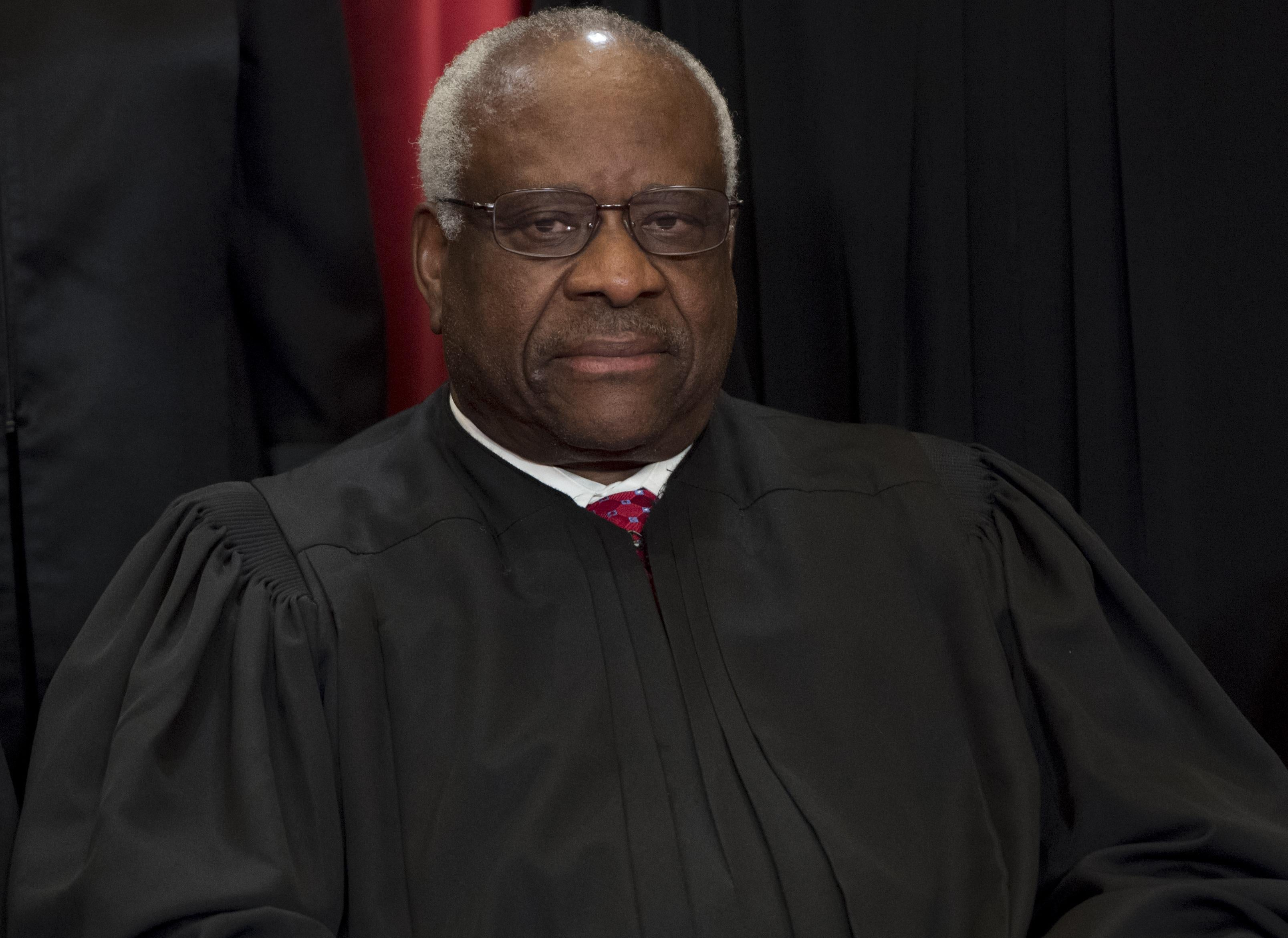 Clarence Thomas in a black robe.
