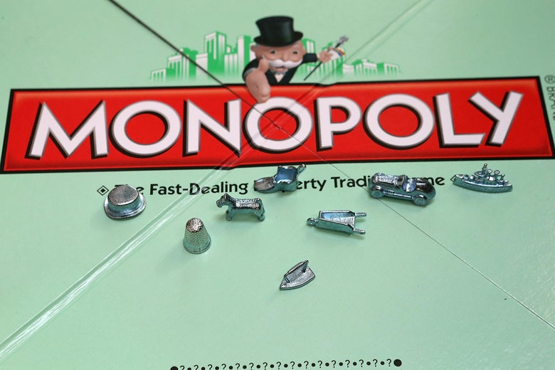 A traditional monopoly board with some of the game's famous tokens.
