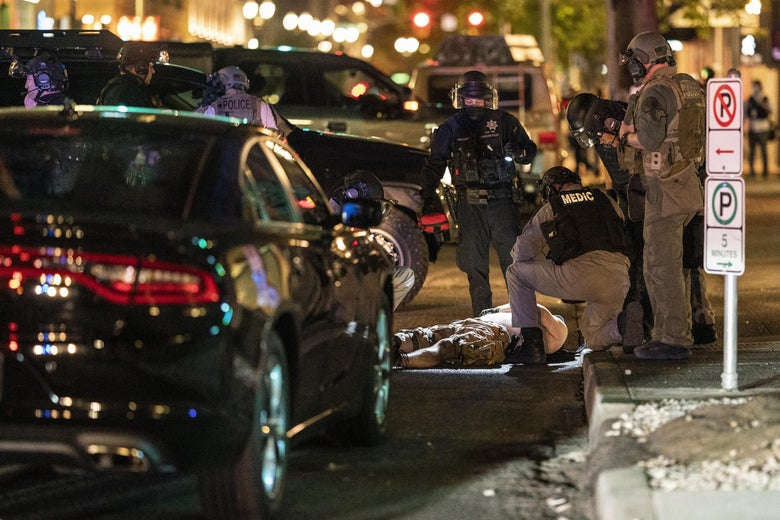 Police arrive to treat a man who was shot near a Pro-Trump rally on August 29, 2020 in Portland, Oregon.
