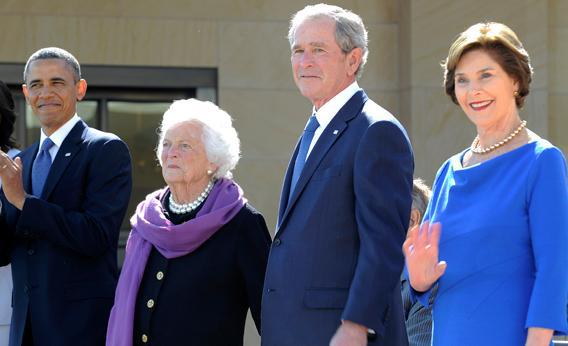 US President Barack Obama, former First Lady Barbara Bush, former US President George H.W. Bush(hidden), former US President George W. Bush and Laura Bush stand on stage during the George W. Bush Presidential Center dedication ceremony in Dallas, Texas, on April 25, 2013.