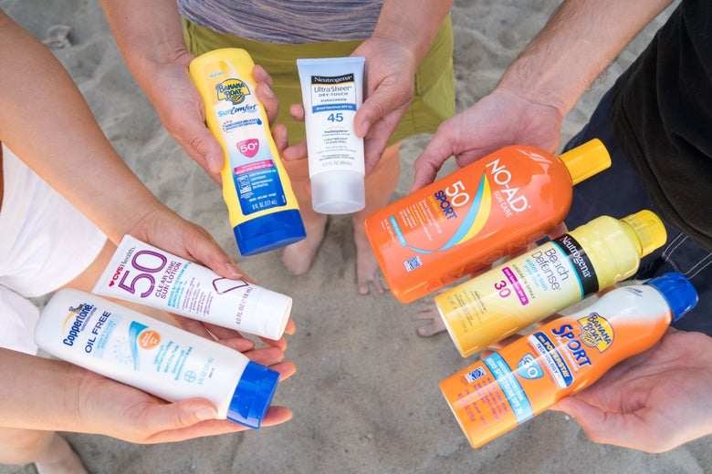 three people holding a variety of sunscreens