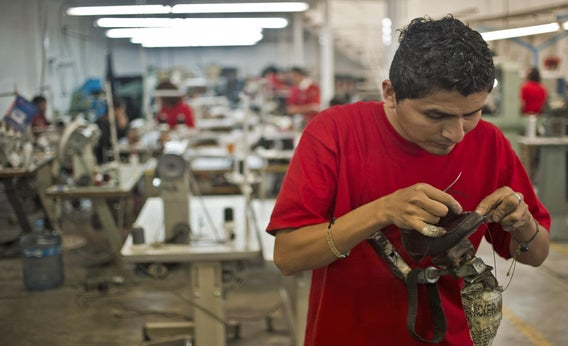A worker sews a shoe in the factory where the shoes given to Pope Benedicto XVI during his 2012 visit to Mexico were made, in Leon, Guanajuato State, on March 1, 2013.