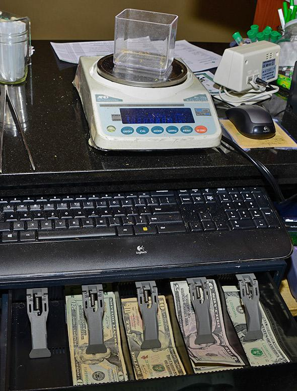A register and a scale from the Denver Relief dispensary in Denver, Colorado, January 2014.