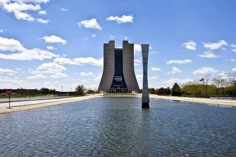 A water feature and sculpture outside the Fermilab.