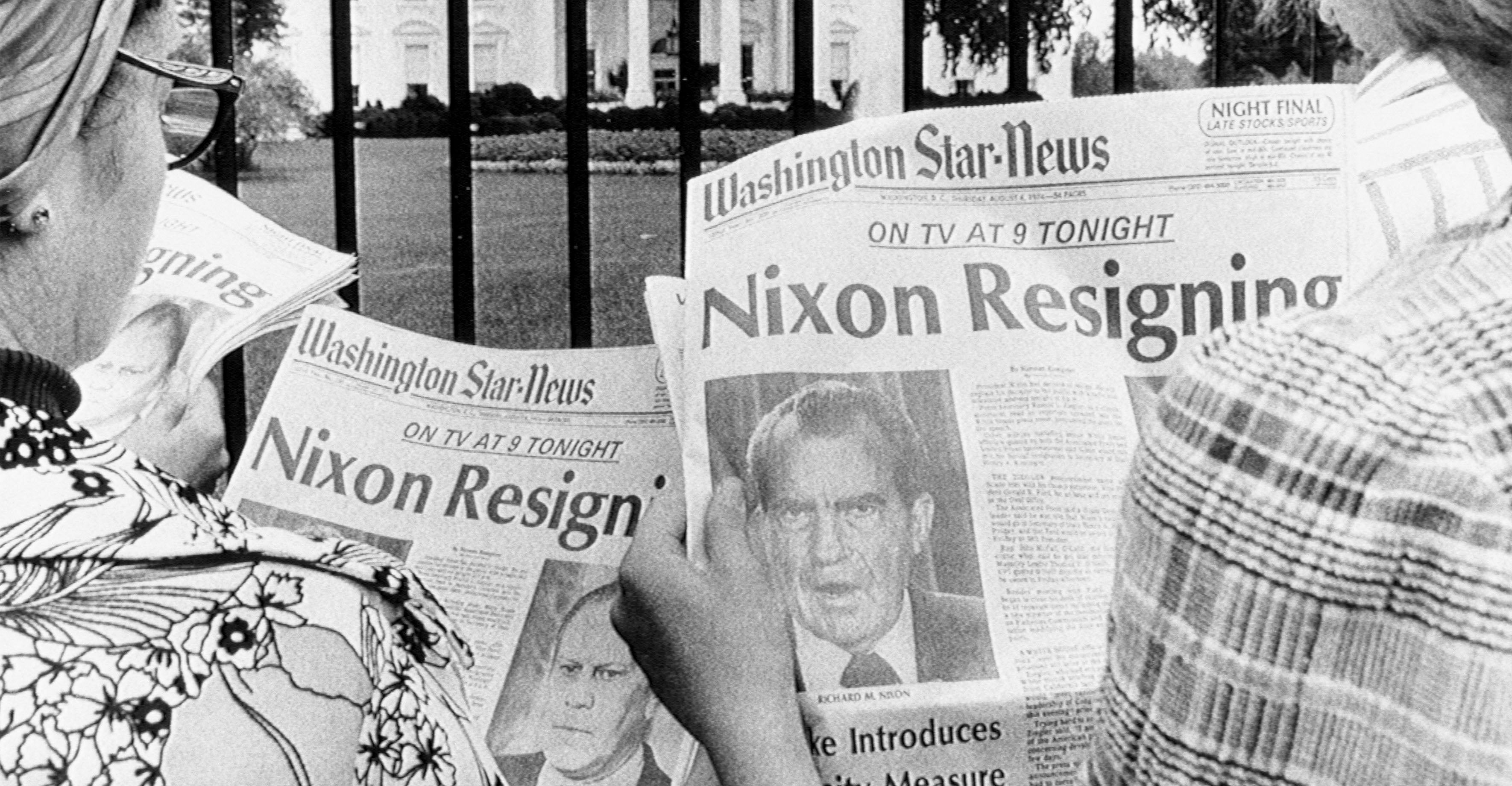 D.C. newspaper headlines being read by tourists in front of the White House on the eve of Nixon's resignation.