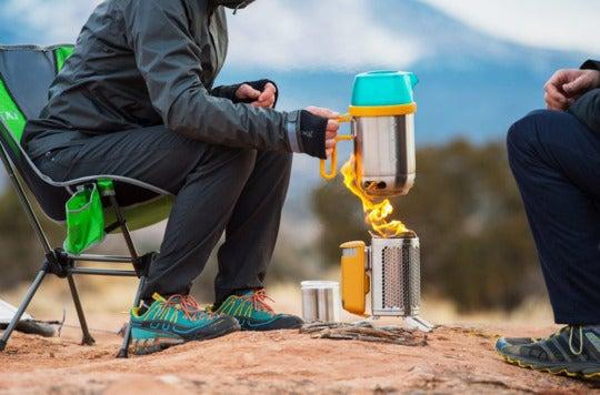 Camper using a BioLite camp stove.
