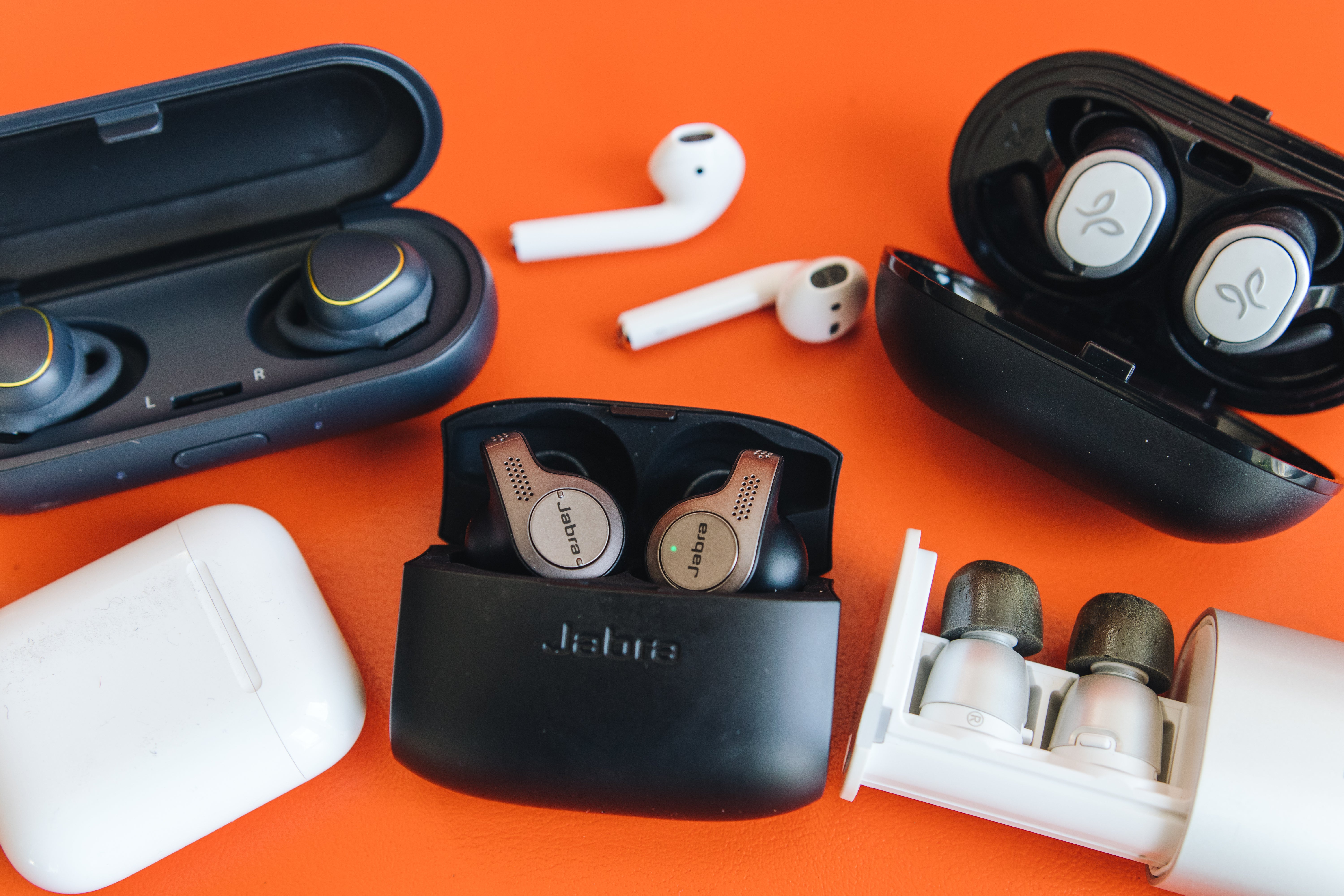 Various earbuds in their cases.