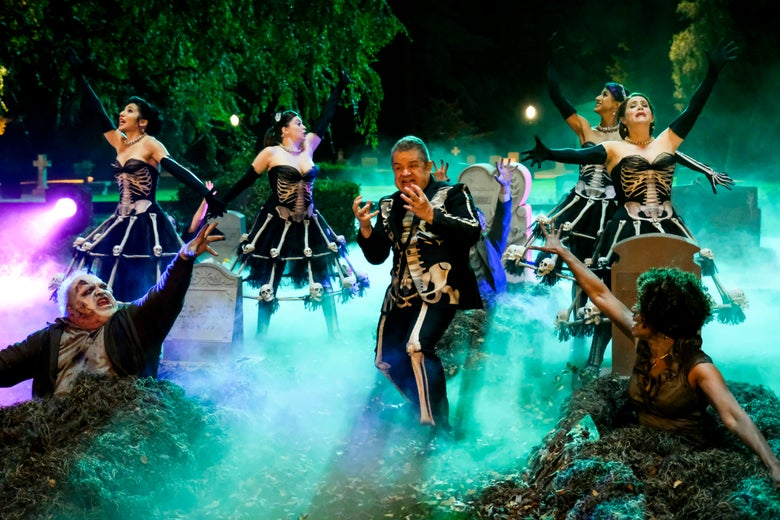 Patton Oswalt in a skeleton suit in a graveyard with backup dancers and other-such ghouls.
