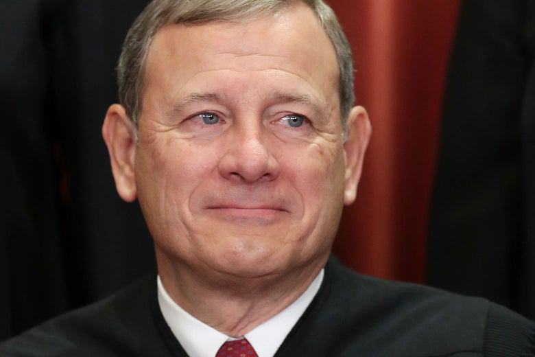 John Roberts in his robes, smiling.