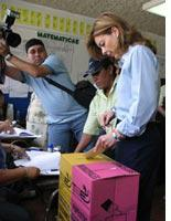 A woman votes in San Salvador Sunday. Click image to expand.