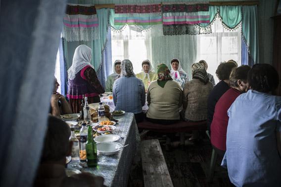 Doukhobor men and women gather to eat and pray, Gorelovka, Georgia.
