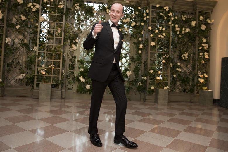 White House Senior Policy Advisor Stephen Miller wearing a tuxedo, smiles and makes a thumbs up gesture, as he arrives at the White House for a state dinner.