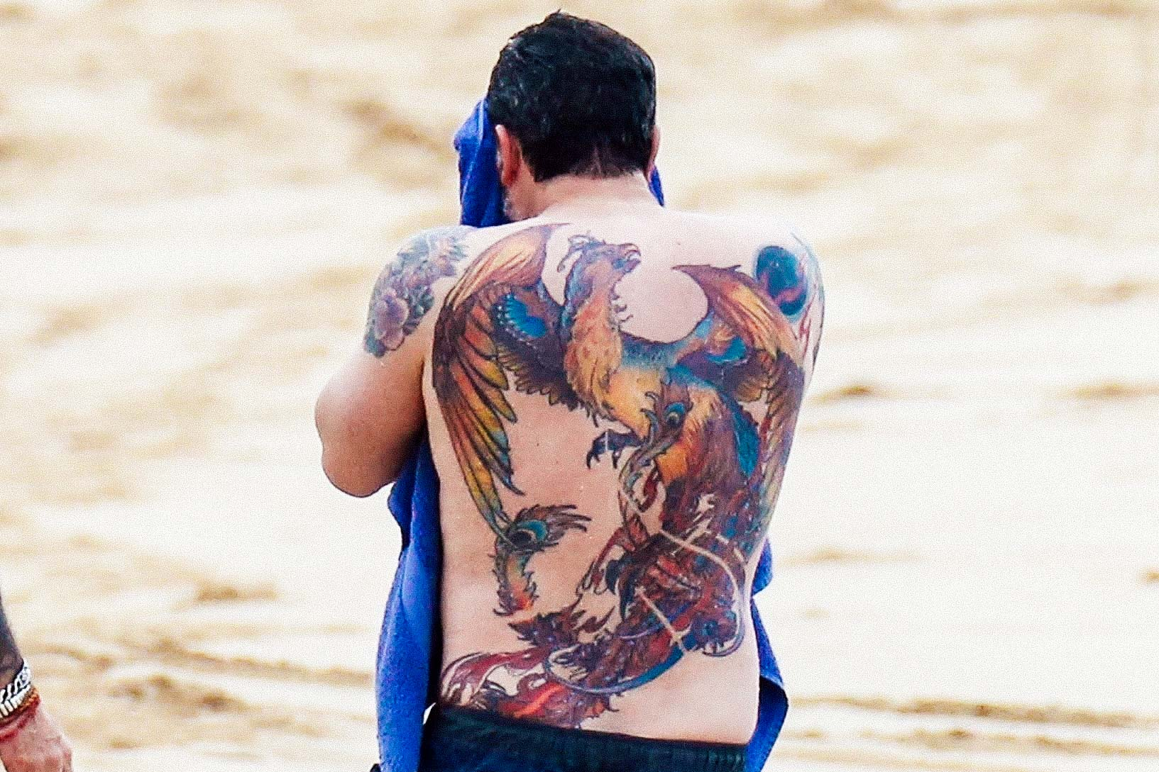 Ben Affleck shows off a huge back tattoo while filming Triple Frontier.