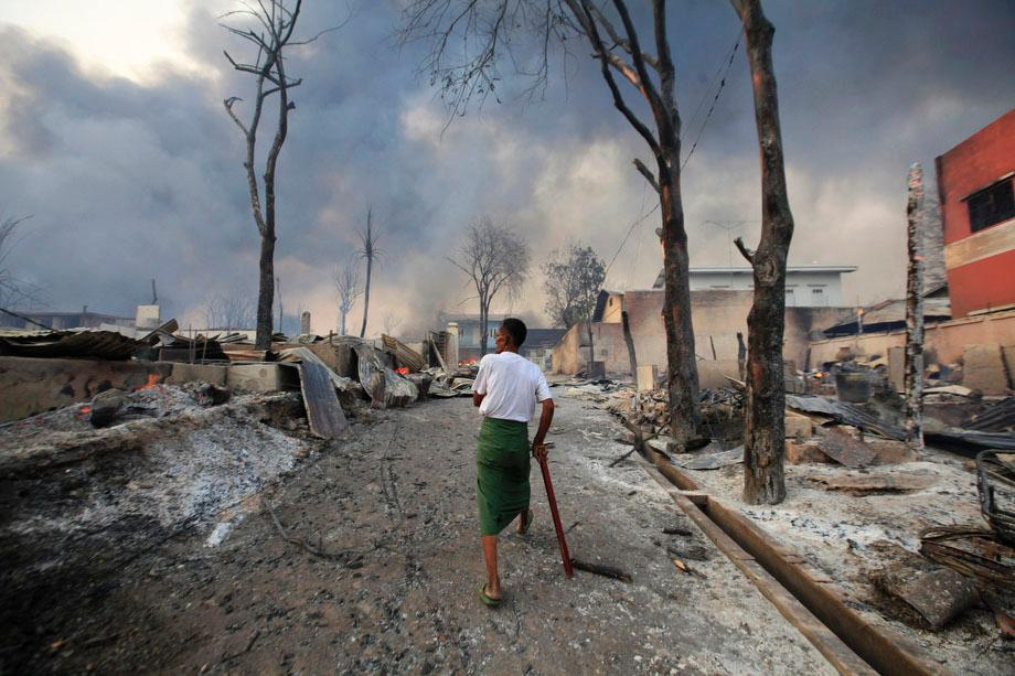 A man walks in Meikhtila, Burma on March 21, 2013. The central Burmese town declared a curfew for a second night on Thursday after clashes killed 10 people, including a Buddhist monk, and injured at least 20, authorities said.