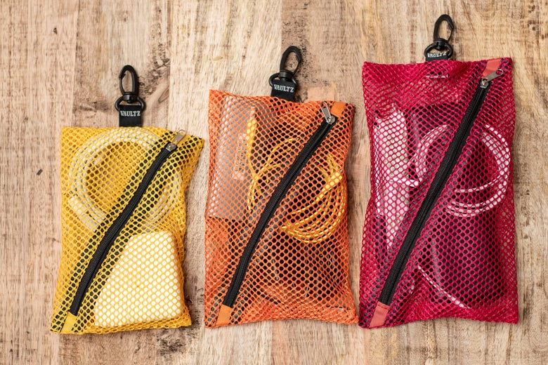 A multipack of colors of Vaultz Mesh Storage Bags