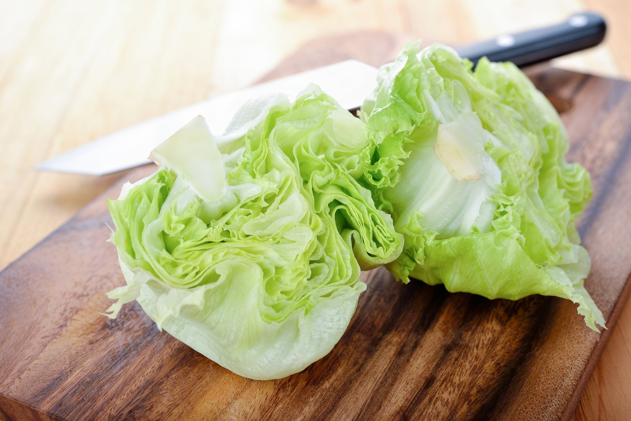 A head of iceberg lettuce, cut in half.