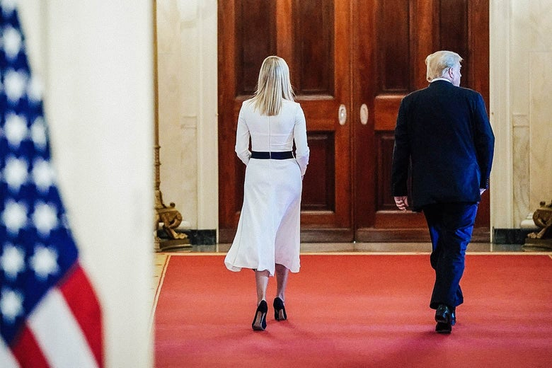 Ivanka Trump, walking down a hallway in the White House, with her father.