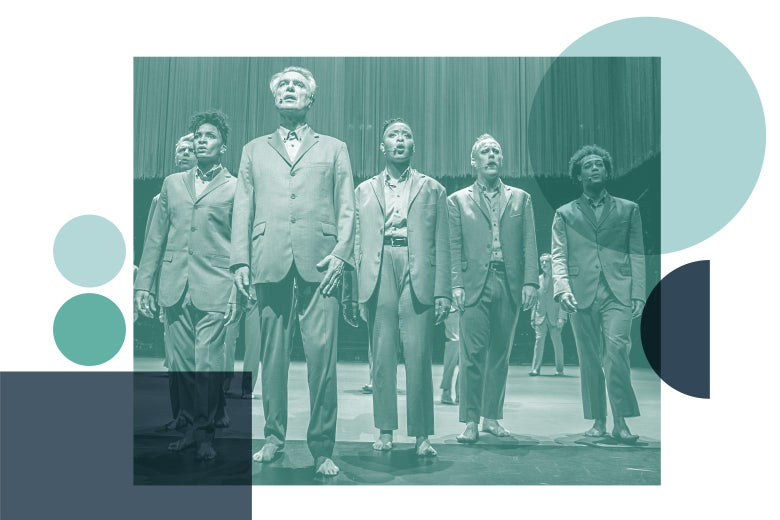 David Byrne and Musicians on a stage in American Utopia.