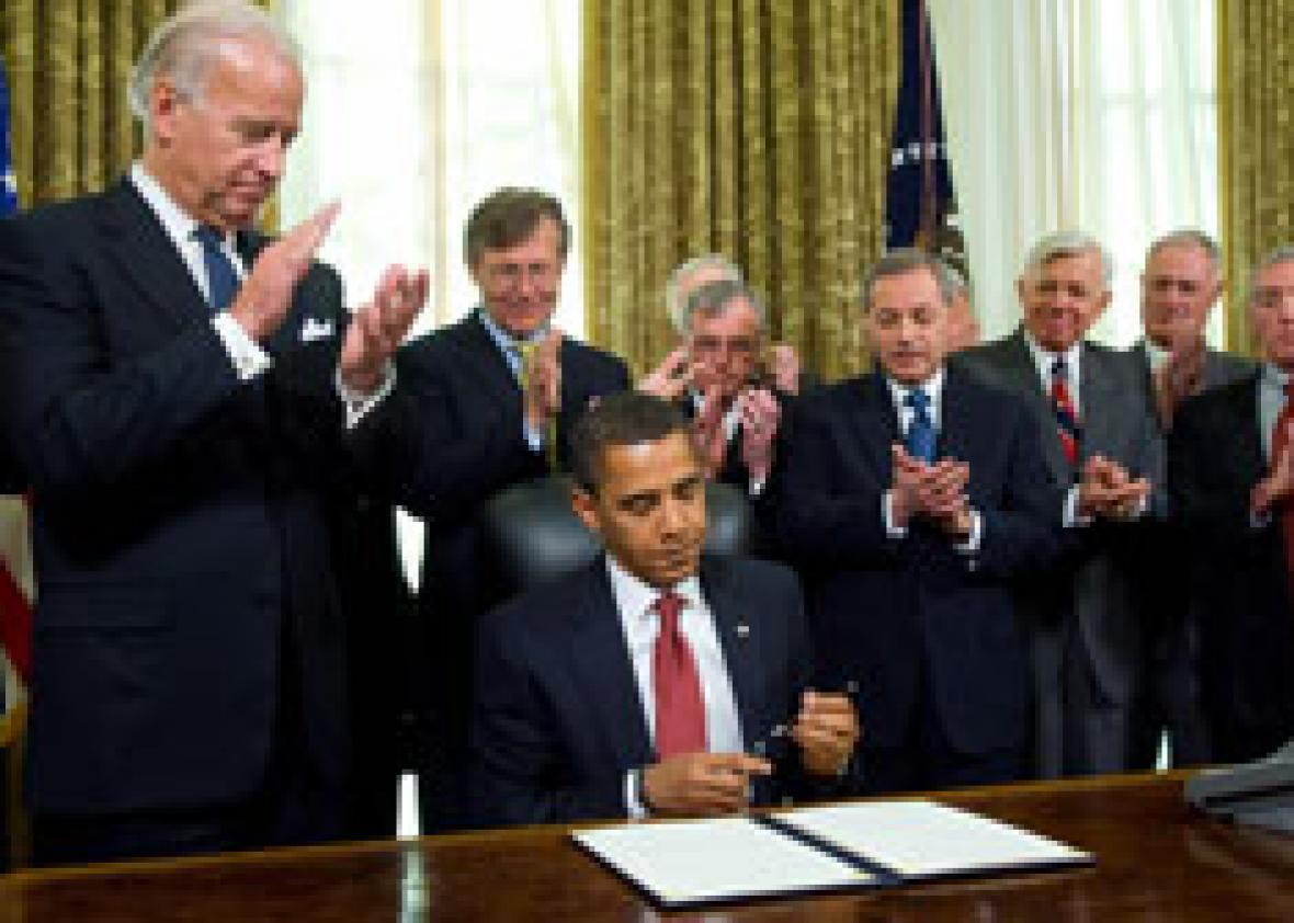 US President Barack Obama puts his pen away after signing an executive order. Click image to expand.