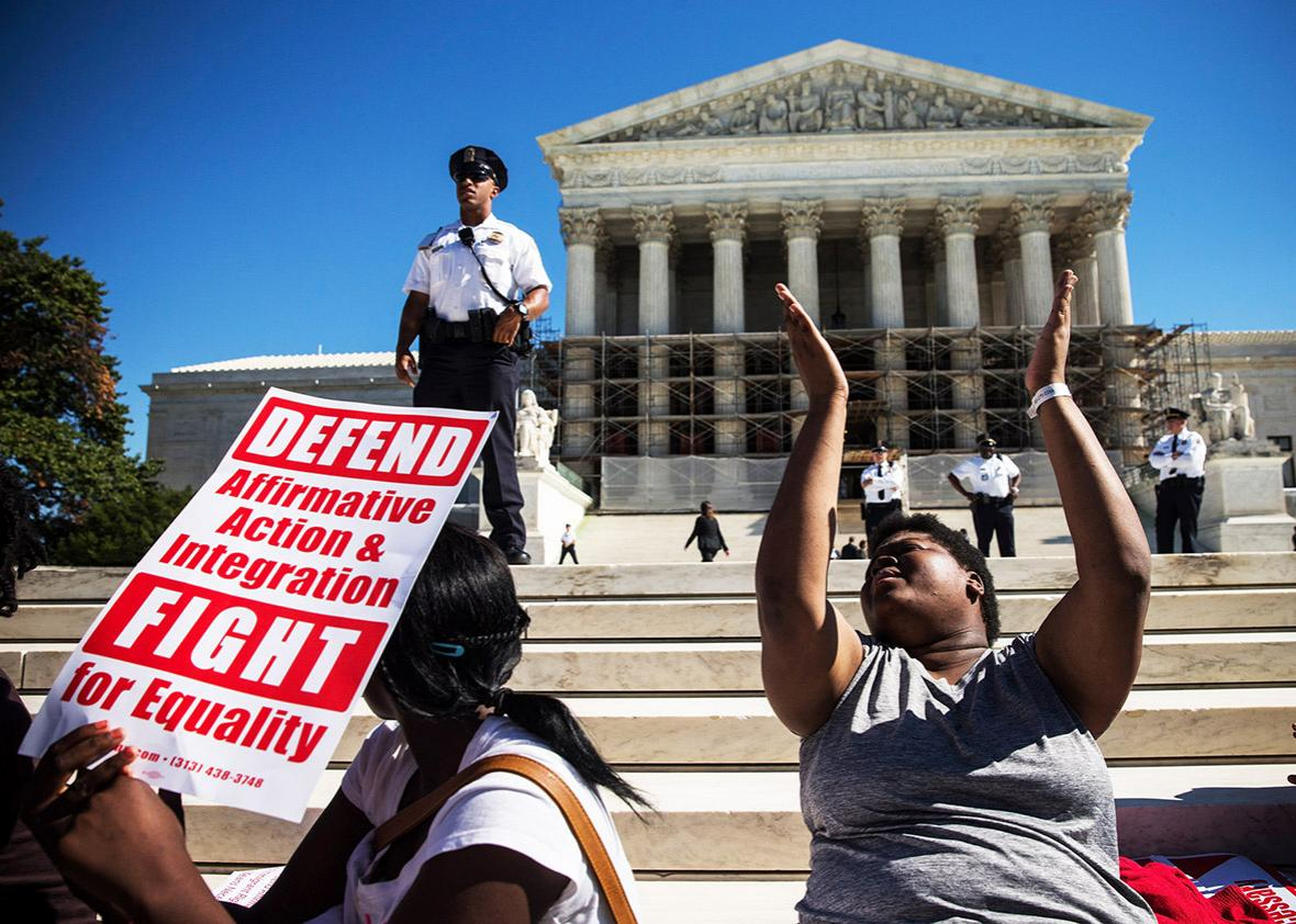 "Students protest in support of affirmative action, outside the Supreme Court during the hearing of ""Schuette v. Coalition to Defend Affirmative Action"" on October 15, 2013 in Washington, DC."