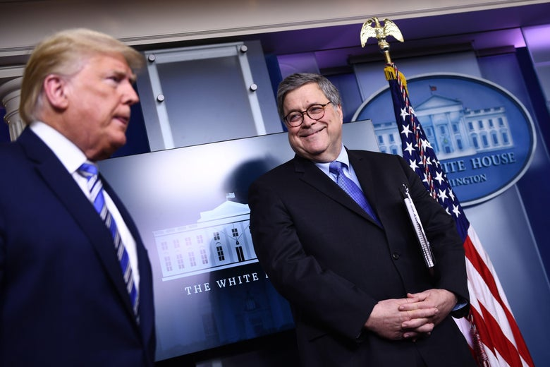 Barr smiles at Trump in the White House press room.