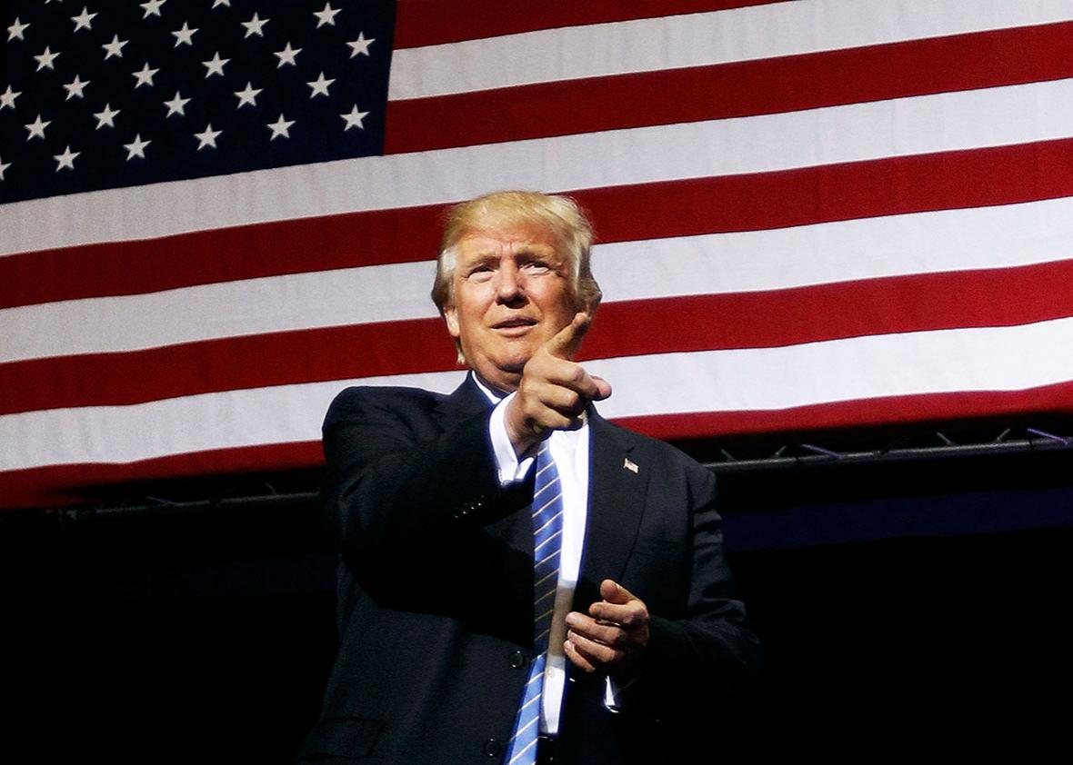 Republican presidential candidate Donald Trump acknowledges supporters as he arrives at a campaign rally on August 31, 2016 in Phoenix, Arizona.