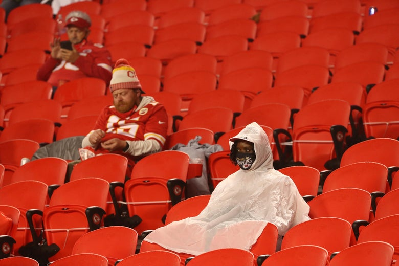 Kansas City Chiefs fans sit at halftime in the rain.