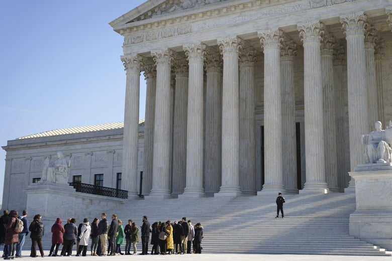People wait in line to get into the Supreme Court