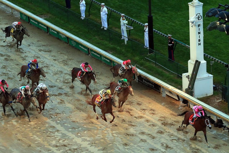 Horses crossing the finish line in the Kentucky Derby.
