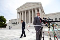 Paul Clement, counsel for the National Rifle Association (right), speaks at a news conference outside the Supreme Court on June 28, 2010 . Click image to expand.