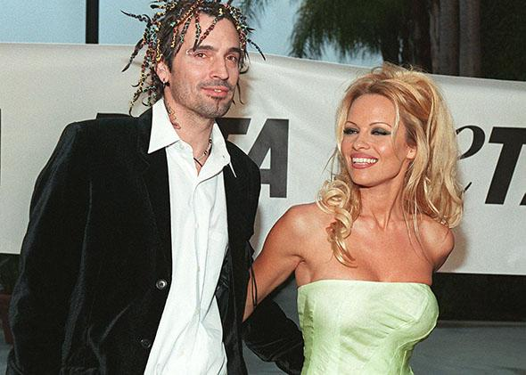 Pamela Anderson Lee arrives at the People for the Ethical Treatment of Animals awards with her husband Tommy Lee in September 1999 in Los Angeles.