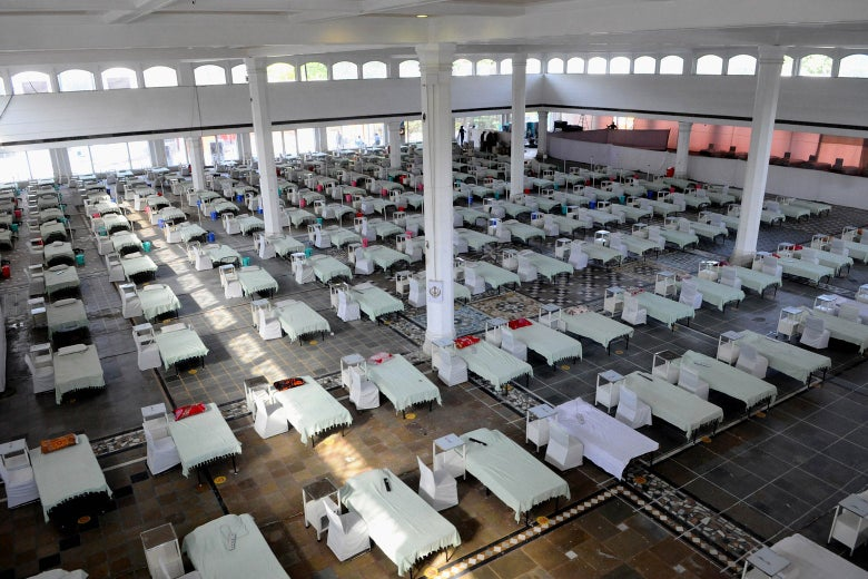 A large room with beds set up for COVID patients.