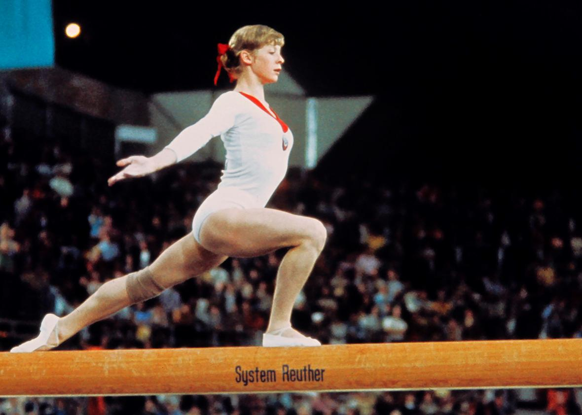 USSR champion Olga Korbut, aged 15, performs on the beam on September 09, 1972 during the Olympic Gymnastics individual event in Munich where she captured four gold medals.
