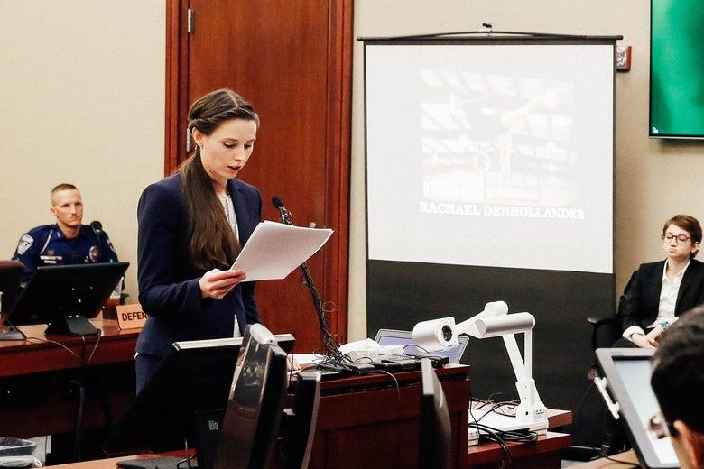 Denhollander reads a statement at a podium in court.