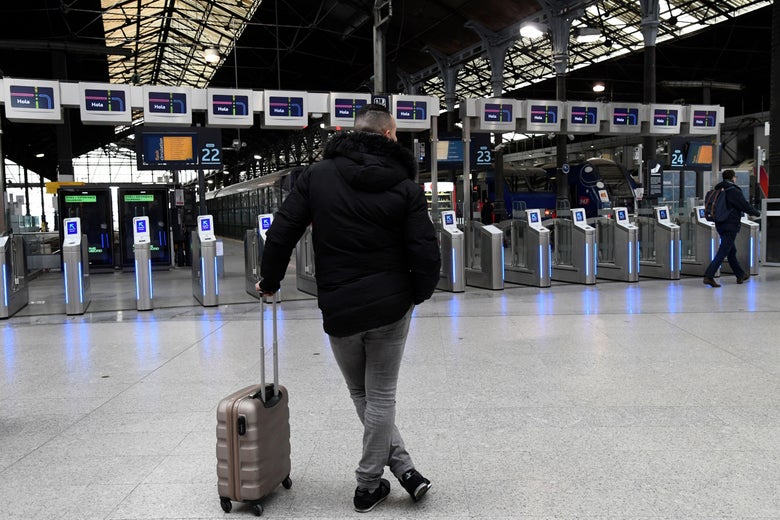 A commuter stands in front of platforms at the Saint-Lazare train station in Paris on April 3, 2018.