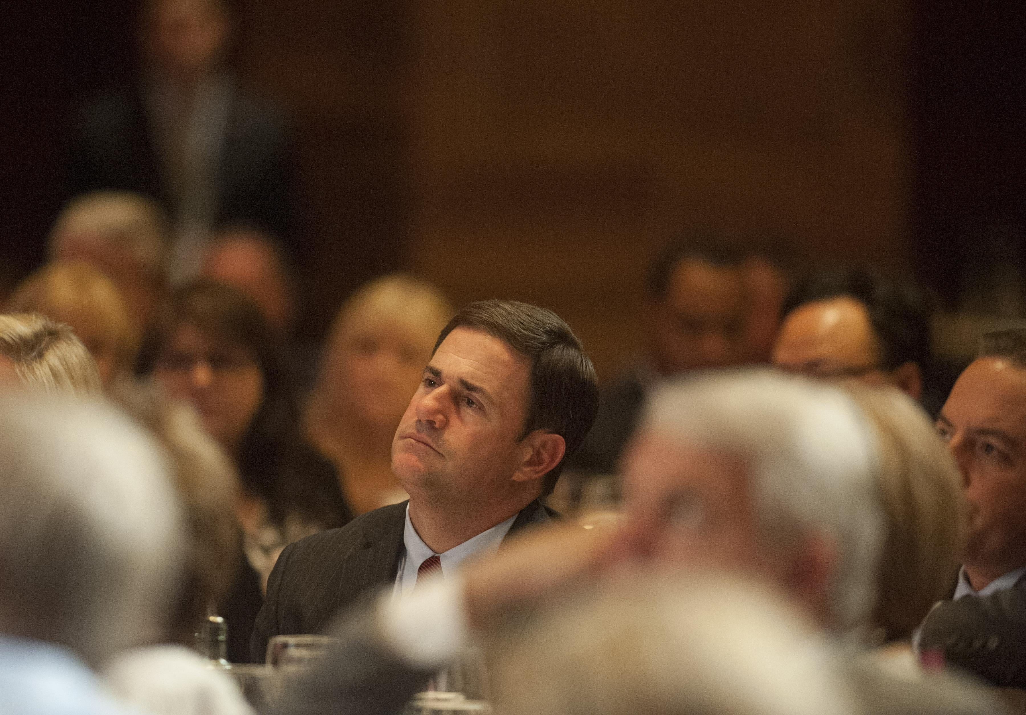 SCOTTSDALE, AZ  - MAY  14:  Arizona Gov. Doug Ducey listens as former Florida Gov. Jeb Bush speaks at a dinner during the Republican National Committee Spring Meeting  at The Phoenician  May 14, 2015 in Scottsdale, Arizona. Bush, brother of former President George W. Bush and son of former President George H.W. Bush, is widely expected to run for the Republican nomination for president in 2016.  (Photo by Laura Segall/Getty Images)
