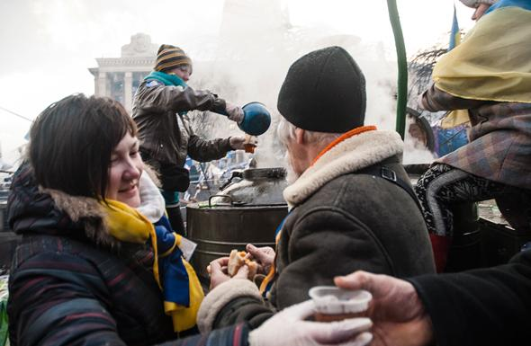 "Protesters drink free ""hot Volyn tea"" at Independence Square."
