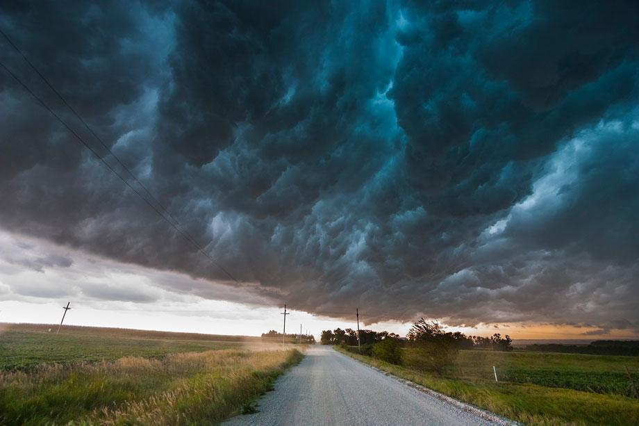 """A shelf cloud moves over a storm chaser, producing a """"whale's mouth"""" in southeast Nebraska, Aug. 9, 2009."""