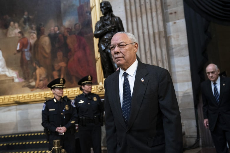 Colin Powell arrives to pay his respects at the casket of the late former President George H.W. Bush as he lies in state at the Capitol